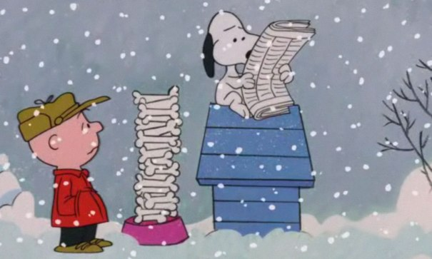 snoopy reading a newspaper